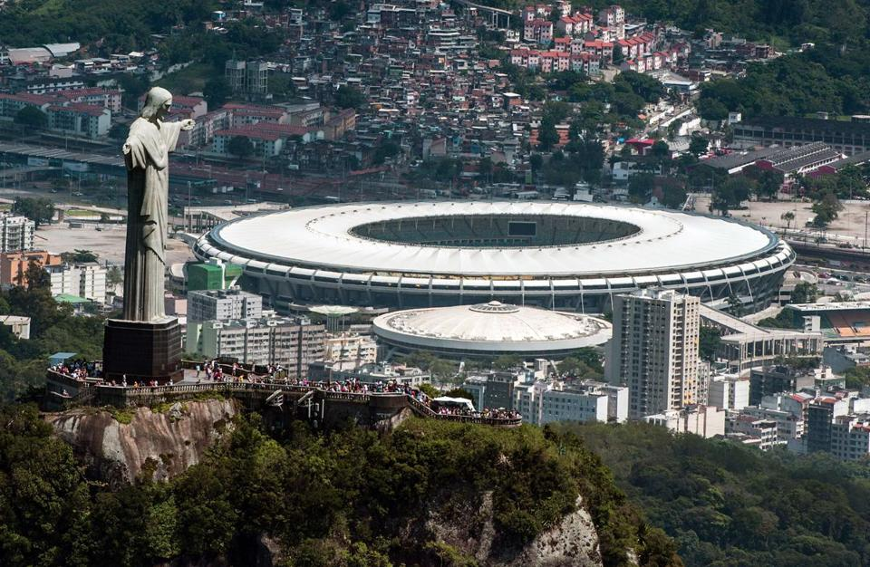 Aerial view of the Christ the Redeemer statue and Maracanã Stadium in Rio de Janeiro, which will host the 2016 Olympics.